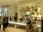 English: The Living and Dying Gallery (Room 24) in the British Museum A fascinating display of objects from around the world relating to life and death which includes a display showing the amount of tablets and pills taken by a person during their lifetim