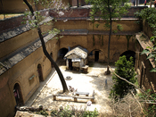 The cave dwellers will dig a courtyard that is about 10 meters deep. After that, rooms are dug off the main courtyard. This is a typical sunken courtyard complex, or pit dwelling in Shaanxi or Henan. Most of the time the dweller live in the caves not out