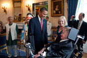 English: President Barack Obama talks with Stephen Hawking in the Blue Room of the White House before a ceremony presenting him and 15 others the Presidential Medal of Freedom on Aug. 12, 2009. The Medal of Freedom is the nation's highest civilian honor.