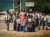 English: Nepalese teacher and schoolchildren in Pokhara