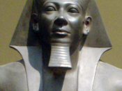 Close-up of Menkaura from the statue of Menkaura and Queen Khamerernebty II. From the Giza Valley Temple of Menkaura, made during his reign (circa 2548-2530 B.C.) Graywacke. Now residing at the Museum of Fine Arts, Boston. Museum Expedition 11.1738
