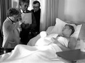 U.S. Congresswoman Barbara Mikulski, D-Md., visits with a patient at the U.S. Air Force hospital as her escorts look on.