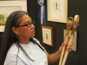 English: Norma Howard (Choctaw Nation of Oklahoma), award-winning watercolor painter with Choctaw stickball sticks made by her son.