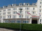 English: Bournemouth : Marriott Highcliff Hotel A 4-star hotel in Bournemouth with 160 guest rooms. The US, UK, and European Union flags are flying outside.