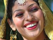 Original title: Smile! You Are On! Original description: She was waiting for her turn to participate in 'Gidha' which is the folk dance from the state of Punjab, India, during the Youth Festival in Amritsar.