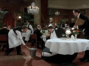 Mr. Creosote (Terry Jones), with the maître d' (John Cleese, right) and second waiter (Eric Idle, left)