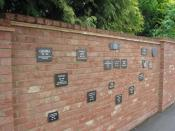 "English: Memorial plaques for Hearing Dogs, Grange Farm, Saunderton This wall, which encloses the garden of the farm house 1343740, carries memorial plaques to some of the ""Hearing Dogs for Deaf People"" www.hearingdogs.org.uk/, including Lady (1980-1998)"