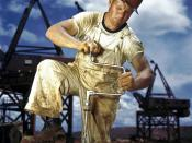 English: 1942 photograph of Carpenter at work on Douglas Dam, Tennessee (TVA).Encyclopedic both as a document of carpentry during that era and as a historic example of early color photography. Supersaturation was popular in the United States during that e