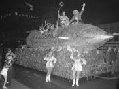 Pre-Christmas parade in downtown; features rocket ship float with Santa Claus in Los Angeles, Calif., 1940