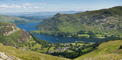 English: The village of Glenridding and Ullswater in the Lake District, Cumbria, England. This view is looking east from the hills at the start of the ascent to Helvellyn.