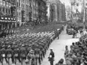 Reichsluftschutzbund personnel march past near the Nuremberg Frauenkirche in the 1934 Nuremberg Rally-Screenshot from Triumph of the Will.