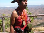 An East Timorese man in traditional attire, including tais mane