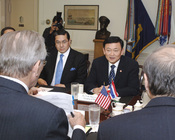 English: Thailand's Prime Minister Thaksin Shinawatra (right) meets with Secretary of Defense Donald Rumsfeld (foreground left) in the Pentagon. Thaksin and Rumsfeld are meeting to discuss issues of mutual interest. Prime Minister Thaksin is accompanied b