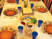 English: Festive Seder table with wine, matza and Seder plate.