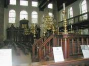Interior of the Amsterdam Synagogue: the bema (or tebáh) is in the foreground, and the Hekhál (Ark) in the background.