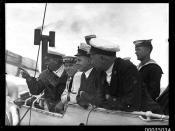 Naval officers and sailors of HMAS ANZAC watching the sinking of HMAS TORRENS I