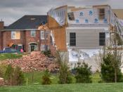 April 2, 2006 Tornado Outbreak, O'Fallon, Illinois, April 2, 2006. House damaged by a tornado, debris from this house damaged neighboring houses. The insurance carrier declared this home a total loss. Home of George and Ellen Hall.