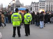 English: Metropolitan Police officers on patrol in London's Trafalgar Square