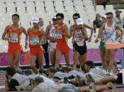 U.S. Army Sgt. John Nunn and U.S. Air Force Capt. Kevin Eastler, along with other competitors, compete in the 20K Racewalk competition during the 2004 Olympics at the Olympic Stadium in Athens, Greece.