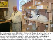 English: Bremerton, WA, March 30, 2001 -- Assisted by Search & Rescue dog Atai`, FEMA Hazard Mitigation Counselor Skip Barber demonstrates at Olympic College ways to retrofit a house for better protection against earthquake damage. This mitigation roa