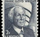 A 1966 U.S. postage stamp honoring Frank Lloyd Wright, with the Guggenheim visible in the background.