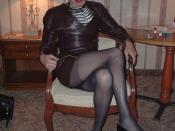 Crossdresser In Leather Suit & High Heels