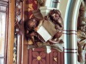 English: Carved monkeys in Library, Cardiff Castle These may be a satire on Darwin's theory of evolution. Monkeys have no idea what to do with a book, so why do humans? sort of argument.