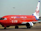 Boeing 737 in the old Virgin Blue red colour scheme