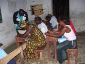 These students in Bong County, Liberia, study by candlelight. They are part of the Accelerated Learning Program in the country, an effort to compress several years of education for older students who missed school during Liberia's civil war. An education
