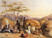 English: Zulu women busy brewing beer. They also made the earthenware which they are using. Afrikaans: Zoeloevrouens besig om bier te brou. Hulle het ook die erdeware gemaak wat hulle gebruik.