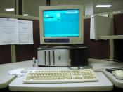 English: Photograph of a typical workstation/desk in a call centre environment. In photograph is workstation displaying CTI software. User is 'Waiting for call'.