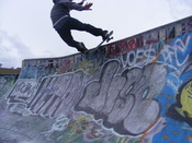 English: A photograph of the skateboarding trick called a Front Side Rock and Roll by Stuart Bermingham.