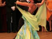 Ball gown and tailcoat are always worn when dancing competitively. This couple are dancing an international standard tango.