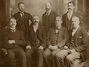 Eugene Debs (front right), Martin J. Elliott (center rear) and other A.R.U. board members in prison together after Pullman strike. Backdrop is fake
