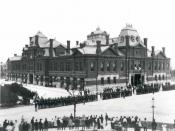Pullman strikers outside Arcade Building in Pullman, Chicago. The Illinois National Guard can be seen guarding the building during the Pullman Railroad Strike in 1894.