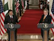 President George W. Bush, of the United States, listens as President Pervez Musharraf, of the Islamic Republic of Pakistan, responds to a question Friday, September 22, 2006 during a joint press availability at the White House.