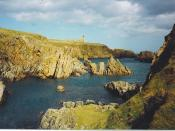 English: Cliffs South of Slains Castle. The castle is a ruin but there are rumours of it being rebuilt inside. It is supposed to be Bram Stoker's inspiration for his novel, Dracula.