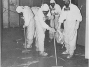 English: TMI personnel cleaning up the contaminated auxiliary building.