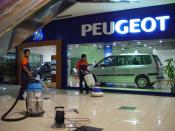 Globalisation: Peugeot in Jakarta, Indonesia. International trade coincides with the expansion of multinational corporations.