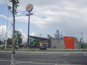 Burger King restaurant building in Chalco, Mexico City. Taken from a parking lot.