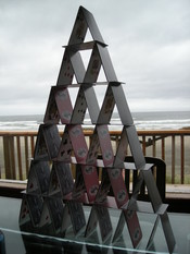 A six-story card castle made from 3 1/2 decks of playing cards.