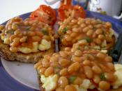 A dish of baked beans over scrambled eggs on toast.