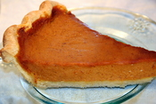 English: A slice of homemade Thanksgiving pumpkin pie served on a glass plate