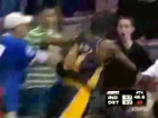 Screenshot of ESPN showing the Pacers-Pistons brawl, at the moment where Ron Artest is charging into the stands, about to punch Mike Ryan who he mistakenly thought was responsible for throwing a cup at him.