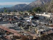 English: The remains of a mobile home park in Sylmar, California. 480 of the park's 600 mobile homes were burned in the Sayre Fire in November 2008. The homes in the background that did not sustain fire damage become uninhabitable due to the lack of utili