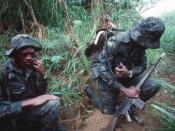 Soldiers of the Guyana Defense Forces relay information to other members of their unit during TRADEWINDS '92, a joint exercise between eleven Caribbean countries, the United Kingdom and the United States. The soldier on the right is armed with a 7.62mm He