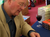 Philip Pullman signing a copy of Lyra's Oxford for a reader, Margaret Maitland, at the Oxford Literary Festival.