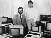 Historic Microsoft photo of Paul Allen (left) and Bill Gates (respectively) on October 19, 1981 surrounded by PCs after signing a major contract with IBM to develop software for its upcoming PC line.