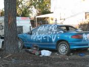 Formerly flooded residential neighborhood of St. Bernard: Auto has inscription asking where insurance company is.
