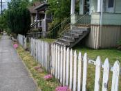 English: Classic picket fence in need of some painting and maintenance.